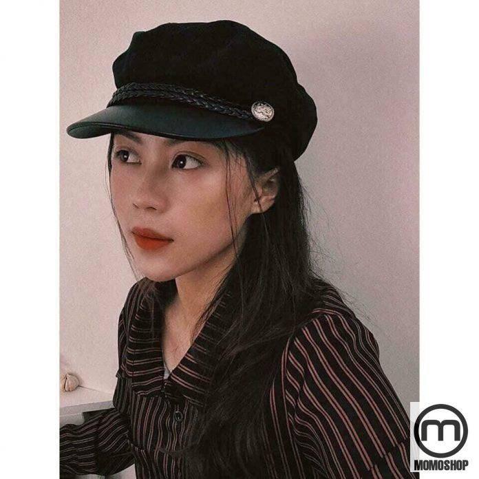 Một chiếc mũ baret thêm một điểm nhấn cho trang phục phong cách vintage của bạn